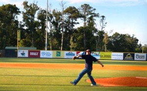 Photo by: Cpl. Santiago Colon, Jr. - Lance Cpl. Cory D. Polom, combat correspondent, Cherry Point public affairs, throws the ceremonial first pitch, Morehead City Marlins baseball game