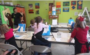 Lindsay Demonch teaches a painting class at Bear Hands Art Factory