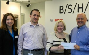 Lori, Worley, President, of Partners In Education; Frank Rebmann, Commercial Director and John Wilson, Human Resources Manager at the New Bern BSH facility along with Darlene Brown, Executive Director of PIE.