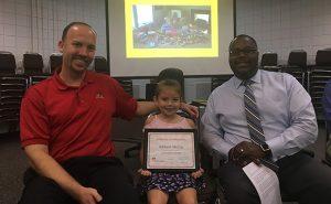 Award presentation to Addison McCoy